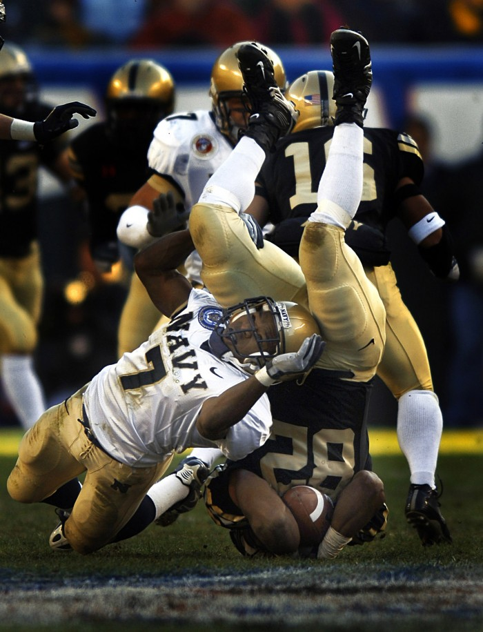 051203-N-9769P-549 Philadelphia, Pa. (Dec. 3, 2005) - Navy Slot Back Reggie Campbell (7) of Sanford, Fla., tackles Army Running Back Scott Wesley (82) during a punt return during the 106th Army vs. Navy Football game held for the third consecutive year at Lincoln Financial Field. The Navy defeated the Black Knights of Army 42-23. The Mids have now won the past four Army-Navy battles bringing the all-time series to 50-49-7. The Navy (7-4) has accepted an invitation to play in the Poinsettia Bowl in San Diego on Dec. 22. U.S. Navy photo by PhotographerÕs Mate 2nd Class Jayme Pastoric (RELEASED)
